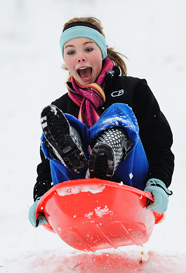 """""""The campus received over 8"""" of snow over the holiday break, most students were still at home with family, but a few came to campus to sled on a big hill by Deaton Dorm."""""""