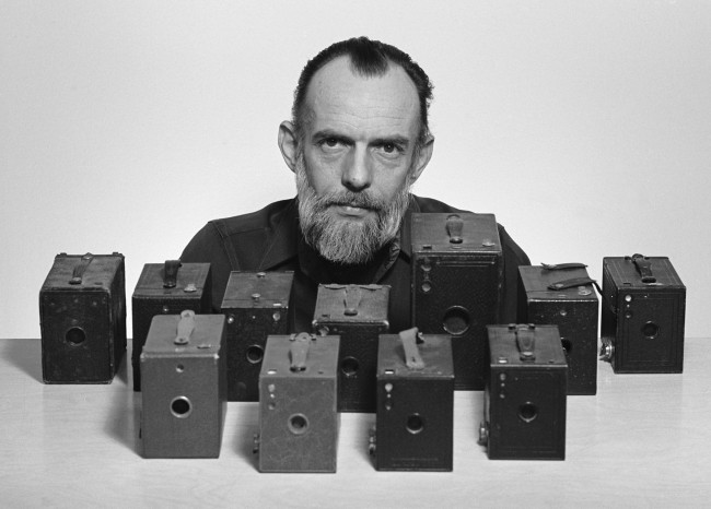 John W. Alley with his box camera collection.